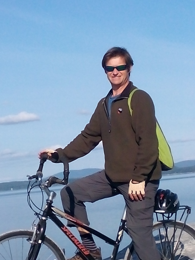 Chas on bike on causeway.jpg